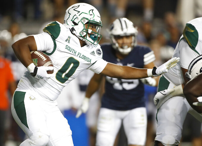 South Florida running back Jaren Mangham (0) looks for an opening in the first half of an NCAA college football game against BYU Saturday, Sept. 25, 2021, in Provo, Utah. (AP Photo/George Frey)