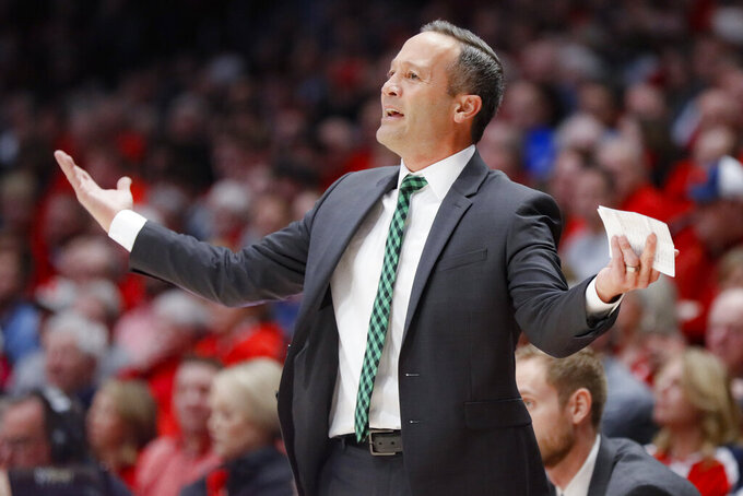 North Texas head coach Grant McCasland reacts after being assessed a technical foul during the first half of an NCAA college basketball game against Dayton, Tuesday, Dec. 17, 2019, in Dayton, Ohio. (AP Photo/John Minchillo)