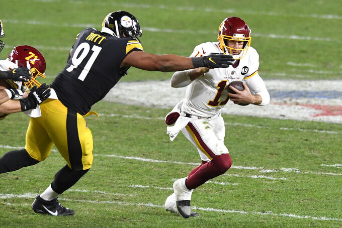 Washington Football Team quarterback Alex Smith (11) is sacked by Pittsburgh Steelers defensive end Stephon Tuitt (91) during the first half of an NFL football game in Pittsburgh, Monday, Dec. 7, 2020. (AP Photo/Barry Reeger)