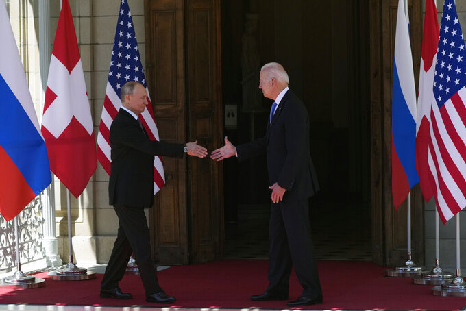 Russian President Vladimir Putin, left, and U.S President Joe Biden shake hands during their meeting at the 'Villa la Grange' in Geneva, Switzerland in Geneva, Switzerland, Wednesday, June 16, 2021. (AP Photo/Alexander Zemlianichenko, Pool)