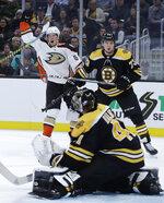 Anaheim Ducks right wing Rickard Rakell, top left, celebrates his goal against Boston Bruins goaltender Jaroslav Halak (41) as Bruins defenseman Charlie McAvoy (73) looks on in the second period of an NHL hockey game, Monday, Oct. 14, 2019, in Boston. (AP Photo/Elise Amendola)