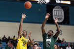 Baylor guard Jared Butler (12) shoots while Ohio guard Lunden McDay (15) defends during the first half of an NCAA college basketball game at the Myrtle Beach Invitational in Conway, S.C., Thursday, Nov. 21, 2019. (AP Photo/Gerry Broome)