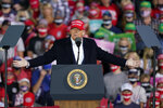 President Donald Trump speaks at a campaign rally at Des Moines International Airport, Wednesday, Oct. 14, 2020, in Des Moines, Iowa. (AP Photo/Charlie Neibergall)