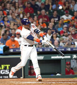 Houston Astros' Yuli Gurriel hits a two-run home run against the Los Angeles Angels during the eighth inning of a baseball game Friday, July 5, 2019, in Houston. (AP Photo/David J. Phillip)