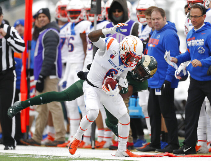 Boise State wide receiver CT Thomas, front is tackled by Colorado State cornerback Andre Neal after pulling in a pass for a short gain in the first half of an NCAA college football game Friday, Nov. 29, 2019, in Fort Collins, Colo. (AP Photo/David Zalubowski)