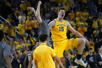 Michigan center Jon Teske (15) reacts to a dunk in the second half of an NCAA college basketball game against Michigan State in Ann Arbor, Mich., Saturday, Feb. 8, 2020. (AP Photo/Paul Sancya)