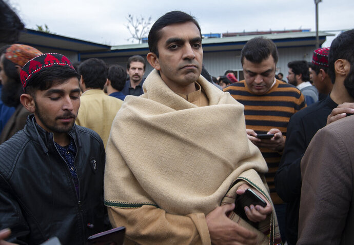 Pakistani legislator and leader of the Pashtun Tahaffuz Movement, Mohsin Dawar arrives at a Press Club to address a news conference in Islamabad, Pakistan, Monday, Jan. 27, 2020. Dawar condemned the arrest of Manzoor Pashteen and announced countrywide protests. Pakistani security forces have arrested Pashteen the leader of a prominent human rights group. The group accuses the military of committing widespread abuses in its war on terror. A local police official said. (AP Photo/B.K. Bangash)