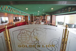 The refurbished bar is ready to receive guests aboard the Queen Elizabeth 2, moored off the Mideast city-state of Dubai, United Arab Emirates, Tuesday, April 17, 2018. Britain's famed luxury cruise ship finally will have a soft opening Wednesday as a floating luxury hotel nearly a decade after arriving here following her last ocean voyage. (AP Photo/Kamran Jebreili)