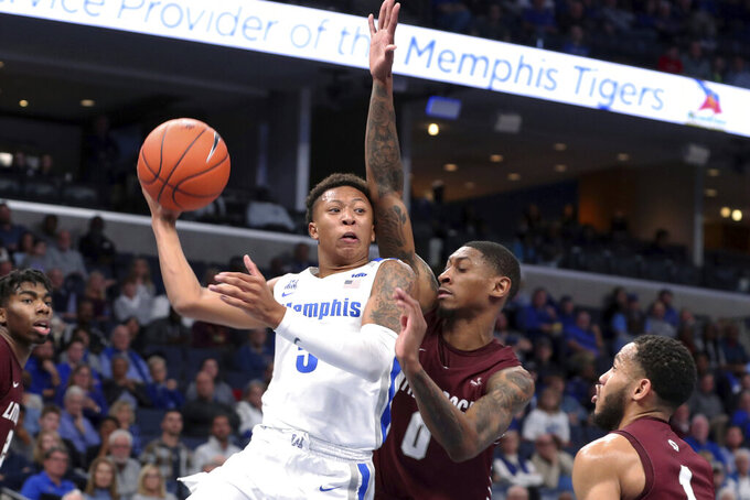 Memphis' Boogie Ellis (5) is defended by Little Rock's Ben Coupet Jr. (0) during the second half of an NCAA college basketball game Wednesday, Nov. 20, 2019, in Memphis, Tenn. (AP Photo/Karen Pulfer Focht)