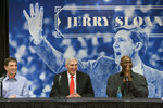 FILE - In this Jan. 31, 2014, file photo, John Stockton, left, and Karl Malone, right, laugh during a news conference to honor former Utah Jazz coach Jerry Sloan, center, in Salt Lake City. The Utah Jazz have announced that Jerry Sloan, the coach who took them to the NBA Finals in 1997 and 1998 on his way to a spot in the Basketball Hall of Fame, has died. Sloan died Friday morning, May 22, 2020, the Jazz said, from complications related to Parkinson's disease and Lewy body dementia. He was 78.(Scott Sommerdorf/The Salt Lake Tribune via AP, File)