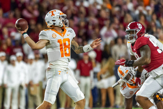 Tennessee quarterback Brian Maurer (18) throws against Alabama during the first half of an NCAA college football game, Saturday, Oct. 19, 2019, in Tuscaloosa, Ala. (AP Photo/Vasha Hunt)