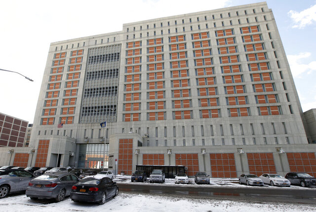 FILE- This Jan. 8, 2017 file photo shows the Metropolitan Detention Center in the Brooklyn borough of New York. The federal Bureau of Prisons announced on Saturday, March 20, 2020, that an inmate at the federal jail has tested positive for coronavirus, marking the first confirmed case in the federal prison system. (AP Photo/Kathy Willens, File)