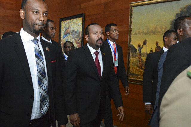 FILE - In this Sunday, Feb. 9, 2020, file photo, Ethiopia's Prime Minister Abiy Ahmed, center, arrives for the opening session of the 33rd African Union (AU) Summit at the AU headquarters in Addis Ababa, Ethiopia. Ethiopia's prime minister on Wednesday, Nov. 4, 2020 ordered the military to confront the Tigray regional government after he said it attacked a military base overnight, citing months of