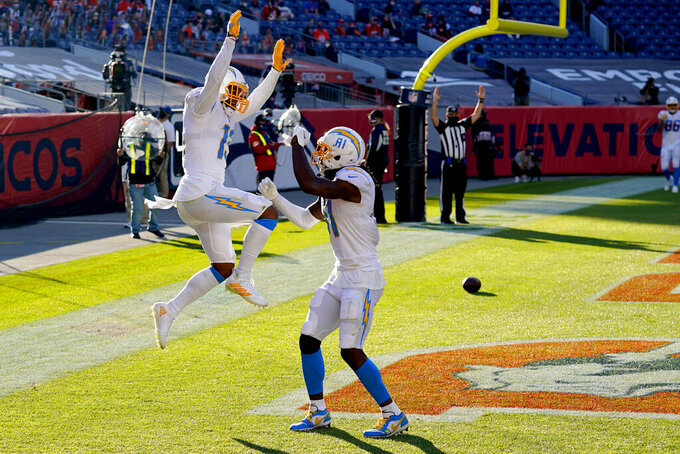 Los Angeles Chargers wide receiver Keenan Allen (13) celebrates his touchdown catch with wide receiver Mike Williams (81) during the first half of an NFL football game against the Denver Broncos, Sunday, Nov. 1, 2020, in Denver. (AP Photo/David Zalubowski)
