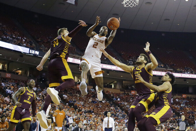 Texas guard Matt Coleman III (2) drives to the basket past Central Michigan forward David DiLeo (14) during the second half of an NCAA college basketball game, Saturday, Dec. 14, 2019, in Austin, Texas. (AP Photo/Eric Gay)