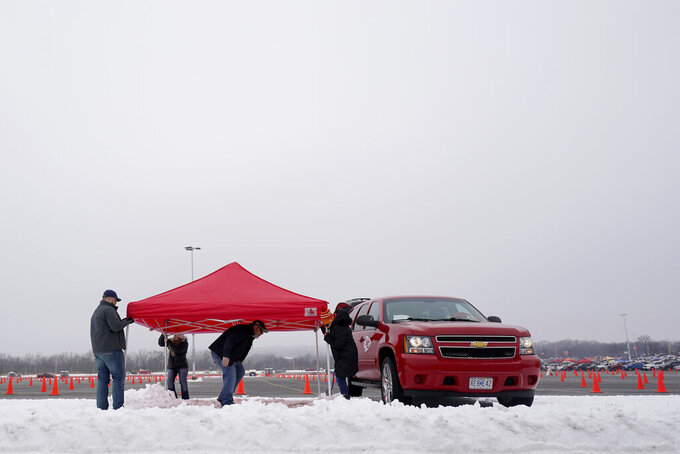Fans set up to tailgate in the parking lot outside Arrowhead Stadium before an NFL football game between the Los Angeles Chargers and the Kansas City Chiefs, Sunday, Jan. 3, 2021, in Kansas City, Mo. (AP Photo/Charlie Riedel)