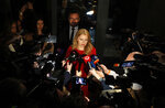 Presidential candidate Zuzana Caputova answers questions to media as she arrives at her election headquarters to watch the results of the first round of the presidential election in Bratislava, Slovakia, Saturday, March 16, 2019. (AP Photo/Petr David Josek)