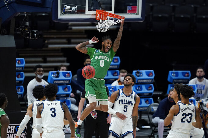 North Texas's James Reese (0) dunks during the first half of a second-round game against Villanova in the NCAA men's college basketball tournament at Bankers Life Fieldhouse, Sunday, March 21, 2021, in Indianapolis. (AP Photo/Darron Cummings)