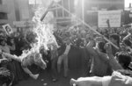FILE- In this Nov. 13, 1979 file photo, Iranian demonstrators burn an effigy of Uncle Sam, branded with CIA on its right arm outside the U.S. Embassy in Tehran, during a demonstration in support of the Iranian militants who took over the embassy November 4. (AP Photo, File)