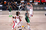 Miami Heat's Goran Dragic (7) grabs a rebound during the second half of an NBA conference final playoff basketball game against the Boston Celtics Friday, Sept. 25, 2020, in Lake Buena Vista, Fla. The Celtics won 121-108. (AP Photo/Mark J. Terrill)