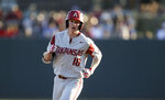 FILE - In this March 22, 2019, file photo, Arkansas' Heston Kjerstad (18) runs around the bases after hitting a solo home run against Alabama during an NCAA college baseball game in Tuscaloosa, Ala. The College World Series has an even stronger Southeastern Conference flavor than usual. Arkansas, Auburn, Mississippi State and Vanderbilt all remain in contention for the national title as SEC schools comprise half the eight-team field.(Gary Cosby Jr./The Tuscaloosa News via AP, File)
