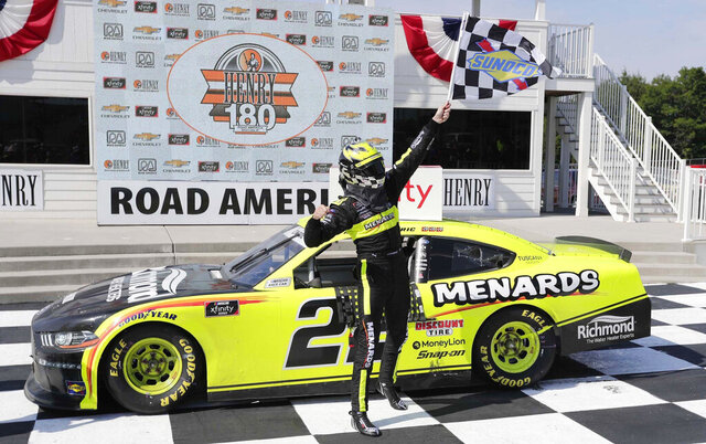 Austin Cindric reacts in Victory Lane after winning a NASCAR Xfinity Series auto race at Road America in Elkhart, Wisc., Saturday, Aug. 8, 2020. (Gary C. Klein/The Sheboygan Press via AP)