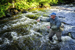 In this June 25, 2019, photo Shawn Perich casts his line while fly fishing in a creek off of Gunflint Trail outside of Grand Marais, Minn. (Evan Frost/Minnesota Public Radio via AP)