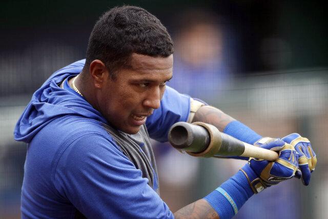 Kansas City Royals' Salvador Perez gets ready to bat during baseball practice at Kauffman Stadium, Thursday, July 16, 2020, in Kansas City, Mo. (AP Photo/Charlie Riedel)