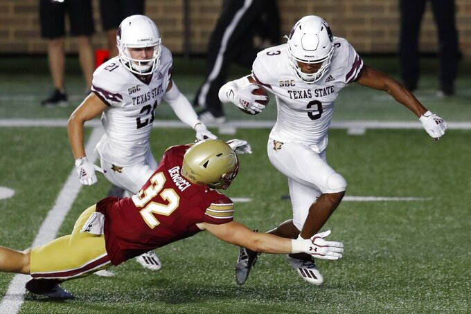 Boston College linebacker Nick DeNucci (32) tackles Texas State wide receiver Jeremiah Haydel (3) on the final play of an NCAA college football game Saturday, Sept. 26, 2020, in Boston. (AP Photo/Michael Dwyer)
