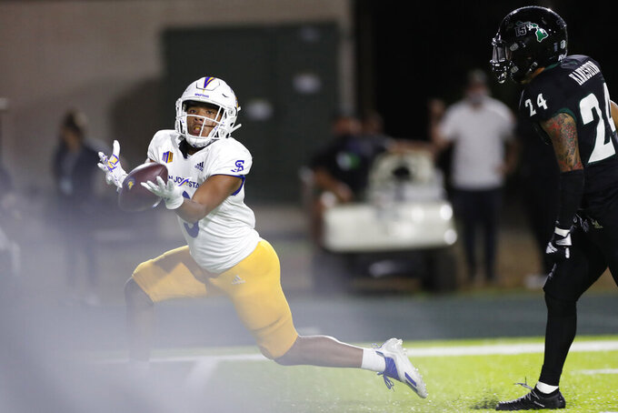 While being guarded by Hawaii defensive back Kai Kaneshiro (24), San Jose State wide receiver Isaiah Hamilton (9) can't pull in a pass in the first half of an NCAA college football game, Saturday, Sept. 18, 2021, in Honolulu. (AP Photo/Marco Garcia)