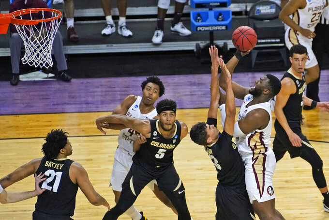 Florida State forward RaiQuan Gray, right, shoots over Colorado forward Tristan da Silva (23) during the second half of a second-round game in the NCAA college basketball tournament at Farmers Coliseum in Indianapolis, Monday, March 22, 2021. (AP Photo/Charles Rex Arbogast)