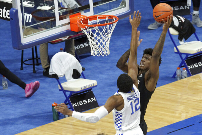 South Carolina's Jalyn McCreary, right, shoots over Kentucky's Keion Brooks Jr. (12) during the second half of an NCAA college basketball game in Lexington, Ky., Saturday, March 6, 2021. (AP Photo/James Crisp)