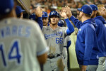 Kansas City Royals' Ryan O'Hearn, center, is congratulated by teammates after scoring a run on a sacrifice fly from Whit Merrifield in the third inning of a baseball game against the Detroit Tigers, Friday, Sept. 24, 2021, in Detroit. (AP Photo/Jose Juarez)