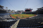 An empty Nationals Stadium is viewed during a Washington Nationals baseball training camp workout Sunday, July 5, 2020, in Washington. (AP Photo/Carolyn Kaster)