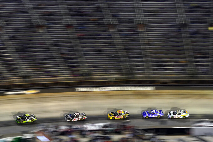 Drivers come through a turn during a NASCAR Xfinity Series auto race at Bristol Motor Speedway Friday, Sept. 17, 2021, in Bristol, Tenn. (AP Photo/Mark Humphrey)