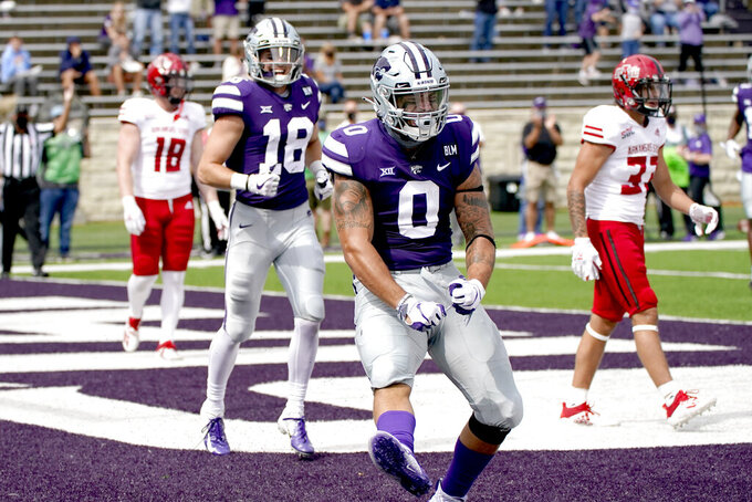 Kansas State tight end Briley Moore (0) celebrates after scoring a touchdown during the first half of an NCAA college football game against Arkansas State Saturday, Sept. 12, 2020, in Manhattan, Kan. (AP Photo/Charlie Riedel)