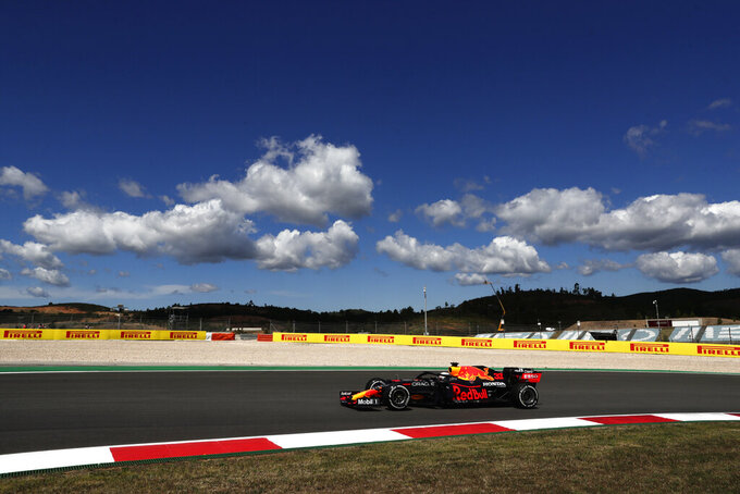 Red Bull driver Max Verstappen of the Netherlands takes a curve during the first free practice session ahead of the Portugal Formula One Grand Prix at the Algarve International Circuit near Portimao, Portugal, Friday, April 30, 2021. The Portugal Grand Prix will be held on Sunday. (AP Photo/Manu Fernandez)