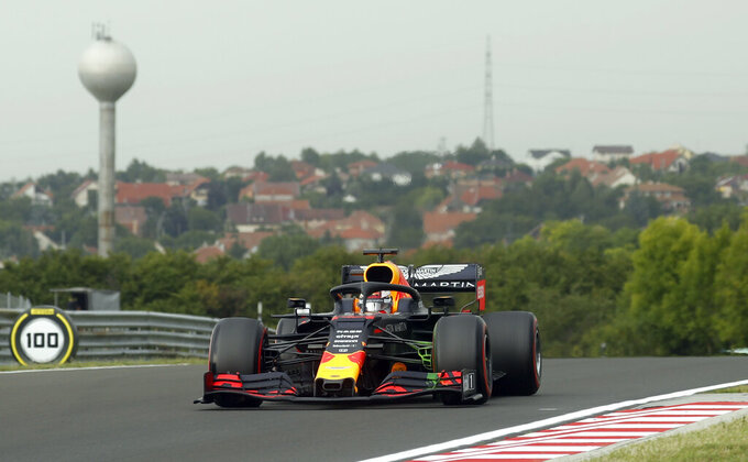 Red Bull driver Max Verstappen of the Netherland's steers his car during the first practice session of the Hungarian Formula One Grand Prix at the Hungaroring racetrack in Mogyorod, northeast of Budapest, Hungary, Friday, Aug. 2, 2019. The Hungarian Formula One Grand Prix takes place on Sunday. (AP Photo/Laszlo Balogh)