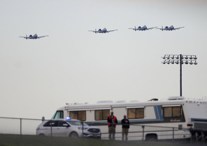 A-10s fly over during the national anthem before a NASCAR Cup Series auto race at Kansas Speedway in Kansas City, Kan., Saturday, May 11, 2019. (AP Photo/Orlin Wagner)