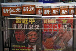 In this July 4, 2019, photo, Chinese magazines with front covers featuring Chinese President Xi Jinping and U.S. President Donald Trump on trade war is placed on sale at a roadside bookstand in Hong Kong. Facing another U.S. tariff hike, Xi is getting tougher with Washington instead of backing down. Both sides have incentives to settle a trade war that is battering exporters on either side of the Pacific and threatening to tip the global economy into recession. (AP Photo/Andy Wong)