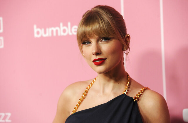 FILE - In this Dec. 12, 2019, file photo, Taylor Swift arrives at Billboard's Women in Music at the Hollywood Palladium in Los Angeles. Swift's father recently fought a burglar who broke into his $4 million Florida penthouse. The Tampa Bay Times reports that Scott Swift returned to his home in the Vinoy Place Towers on Jan. 17, 2020, just moments after 30-year-old Terrence Hoover used an emergency stairwell to climb 13 floors to enter it. (AP Photo/Chris Pizzello, File)