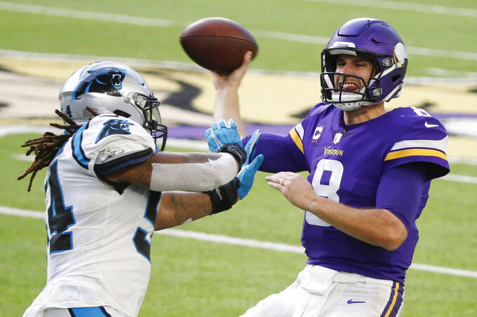 Minnesota Vikings quarterback Kirk Cousins (8) is pressured by Carolina Panthers linebacker Shaq Thompson during the second half of an NFL football game, Sunday, Nov. 29, 2020, in Minneapolis. (AP Photo/Bruce Kluckhohn)