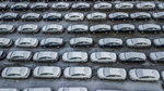 FILE - In this Dec. 5, 2018 file photo, hundreds of Chevrolet Cruze cars sit in a parking lot at General Motors' assembly plant in Lordstown, Ohio.  The long-struggling Rust Belt community of Youngstown, Ohio, which was stung by the loss of the massive General Motors Lordstown plant this year, wants to become a research and production hub for electric vehicles.. But Youngstown faces competition from places like Detroit and China that are taking big roles in developing electric vehicles. (Andrew Rush/Pittsburgh Post-Gazette via AP, File)