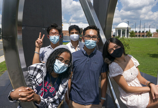 Rising seniors at the Thomas Jefferson High School for Science and Technology gather on the campus in Alexandria, Va., Monday, Aug. 10, 2020. From left in front are, Dinan Elsyad, 17, Sean Nguyen, 16, and Tiffany Ji, 17. From left at rear are, Jordan Lee, 17, and Shibli Nomani, 17. (AP Photo/J. Scott Applewhite)