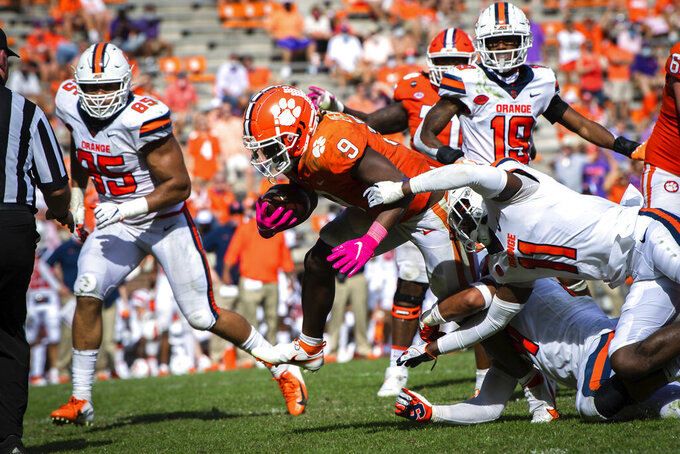 Clemson running back Travis Etienne (9) dives into the end zone for a touchdown in the second half of an NCAA college football game against Syracuse in Clemson, S.C., on Saturday, Oct. 24, 2020. (Ken Ruinard/Pool Photo via AP)