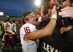 Washington State quarterback Gardner Minshew is congratulated by fans as he leaves the field after an NCAA college football game against Colorado Saturday, Nov. 10, 2018, in Boulder, Colo. Washington State won 31-7. (AP Photo/David Zalubowski)