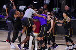 Los Angeles Lakers players celebrate at the end of an NBA conference final playoff basketball game against the Denver Nuggets Sunday, Sept. 20, 2020, in Lake Buena Vista, Fla. The Lakers won 105-103. (AP Photo/Mark J. Terrill)