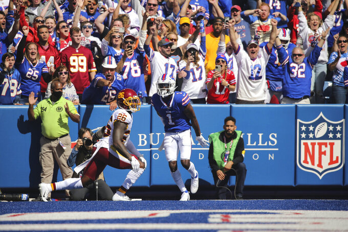 Fans cheer after Buffalo Bills' Emmanuel Sanders (1) caught a pass for a touchdown in front of Washington Football Team strong safety Landon Collins (26) during the first half of an NFL football game Sunday, Sept. 26, 2021, in Orchard Park, N.Y. (AP Photo/Jeffrey T. Barnes)