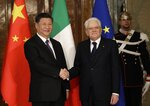 Chinese President Xi Jinping, left, shakes hands with Italian President Sergio Mattarella at the Quirinale Presidential Palace, in Rome, Friday, March 22, 2019. Jinping is launching a two-day official visit aimed at deepening economic and cultural ties with Italy through an ambitious infrastructure building program called