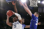 Villanova guard Phil Booth (5) goes up for a shot against Seton Hall center Romaro Gill (35) and forward Sandro Mamukelashvili (23) during the first half of an NCAA college basketball final game in the Big East men's tournament, Saturday, March 16, 2019, in New York. (AP Photo/Julio Cortez)